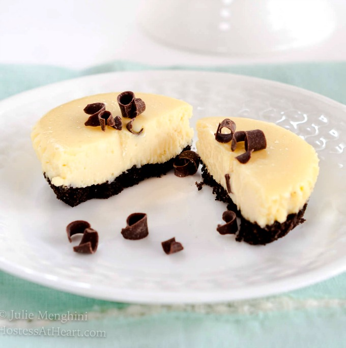 Decadent creamy Baileys Cheesecake nestles in a chocolate crumb crust are cool, luscious and delicious
