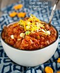 Down Home Chili No Beans Recipe is a spicy tomato stew loaded with pork and beef, peppers and onions.