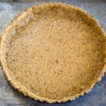 The pecan torte dough is pressed smoothly into a tart shell of the Homemade Sweet Cherry Torte.
