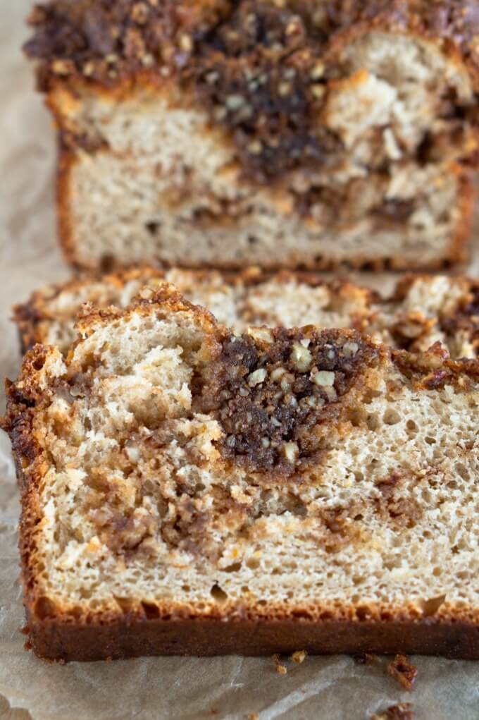 The inside crumb of this slice or Orange-Pecan Streusel Coffee Cake is soft and tender and loaded with sweet brown sugar pecan streusel.