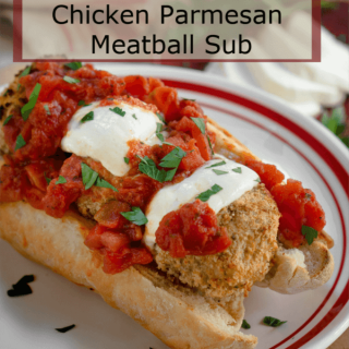 A hoagie roll loaded with fresh marinara, melted mozzarella over chicken parmesan meatballs