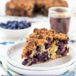 A slice of blueberry buckle is loaded with big berries and topped with an oven-browned streusel topping.