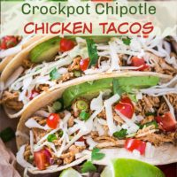 Three tacos filled with shredded chipotle chicken cabbage avocado & tomatoes