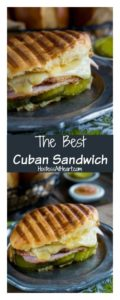 Cuban Sandwich over-filled with pork, melted cheese, pickles inside a browned bread roll
