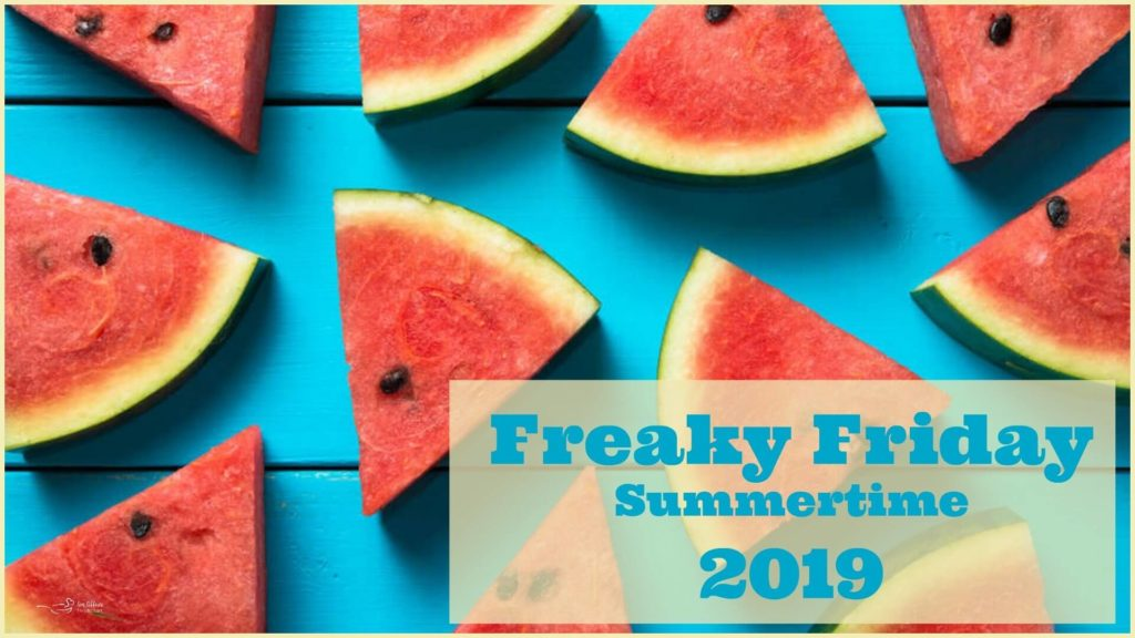 Blue wooden background with slices of watermelon scattered on top with Freaky Friday summertime banner
