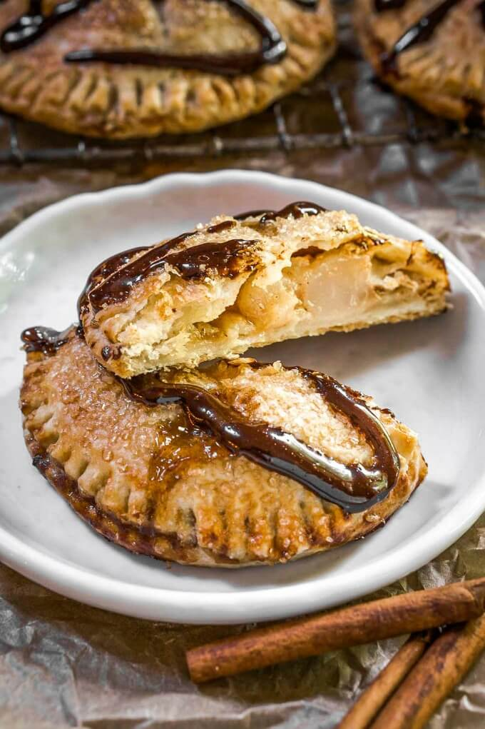 Baked round pie crust filled with diced pears and drizzled with dark chocolate