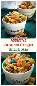Two bowls overflowing snack mix of crispix, m and m's and peanuts small bowls painted with yummy on the front.