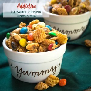 Close up of two bowls of Crispix cereal, peanuts and m and m coated in a caramel glaze sitting on a green napkin.