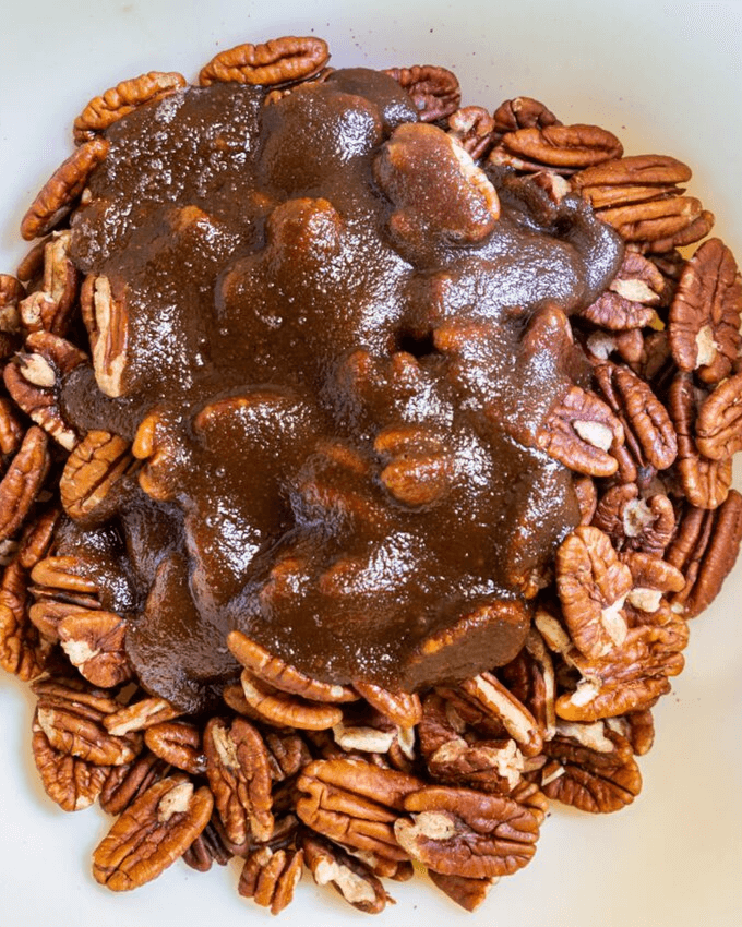 Top view of pecans topped with a butter brown sugar caramel sauce