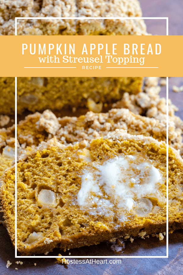 Pumpkin bread dotted with chunks of apple and streusel topping with melted butter on a slice