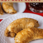 Title text on top of a picture of two browned nut rolls on a white plate over a red napkin.