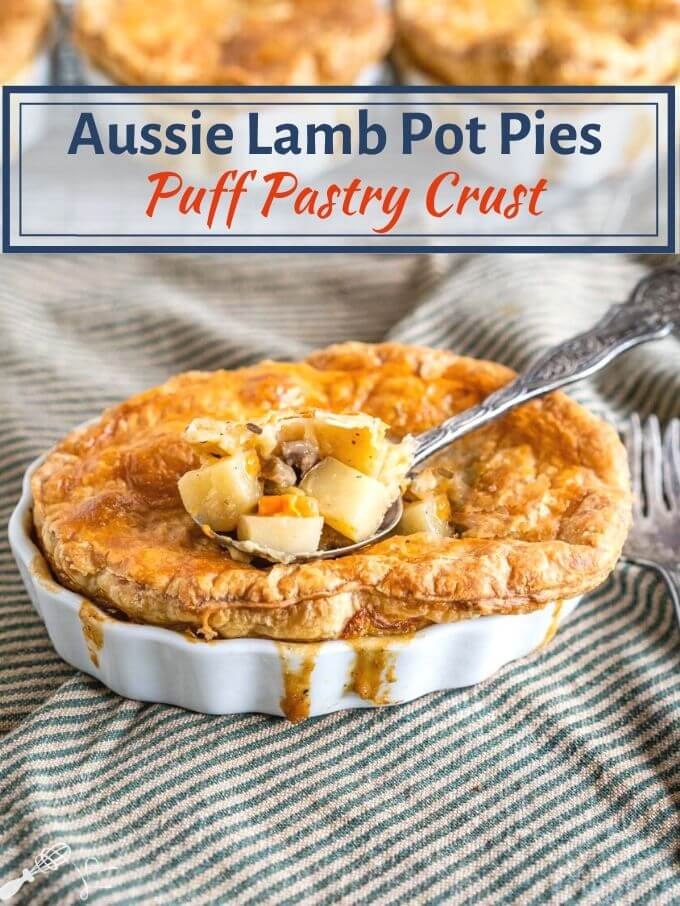 White ramekin filled with a lamb pot pie topped with golden puff pastry and filling spilling down the sides. A spoon of the ingredients is scooped from the center. The dish sits on a green-striped napkin with an antique fork next to the dish. The title runs across the top of the photo.