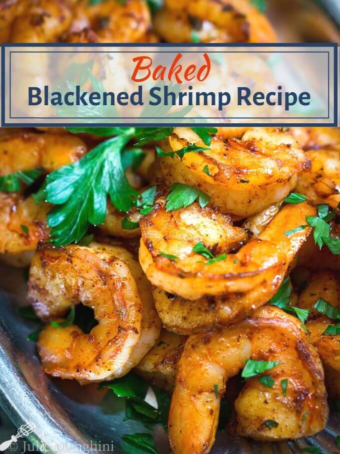 "Close up of spicy red plump shrimp on a silver platter garnished with fresh green parsley. The title ""Baked Blackened Shrimp Recipe appears at the top."
