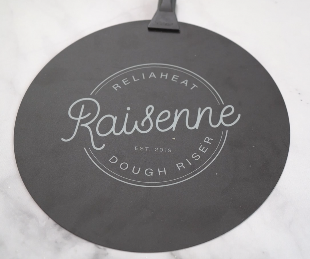 Photo of a Raisenne Dough Riser sitting on a marble background.
