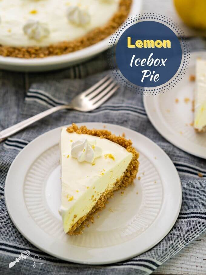 "Slice of Lemon Icebox pie with a creamy lemon filling over a thick graham cracker crust on a white plate sitting over a blue striped napkin. A fork, a partial second piece of pie and the pie is in the background. The title ""Lemon Icebox Pie Recipe"" is in the upper right hand corner."