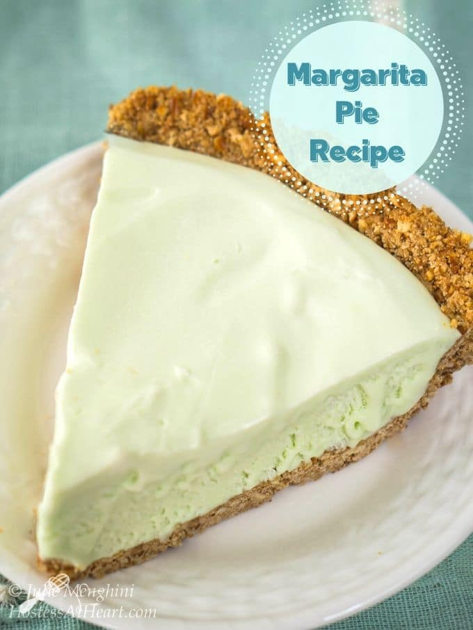 "Top down photo of a slice of frozen margarita pie in a pretzel crust. This light green pie sits on a white plate with the title ""Margarita Pie Recipe"" in the upper right corner."