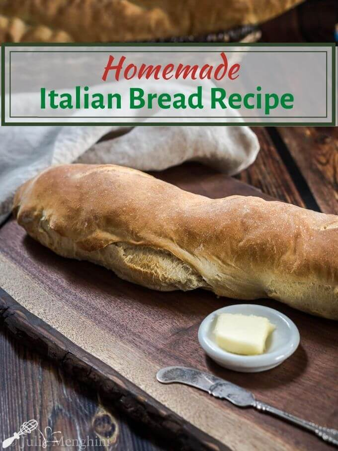 """Half of a loaf of Italian Bread on a wooden cutting board. A pad of butter in a white dish sits next to the bread with a grey linen napkin in the background. The title """"Italian Bread Recipe"""" runs across the top right."""