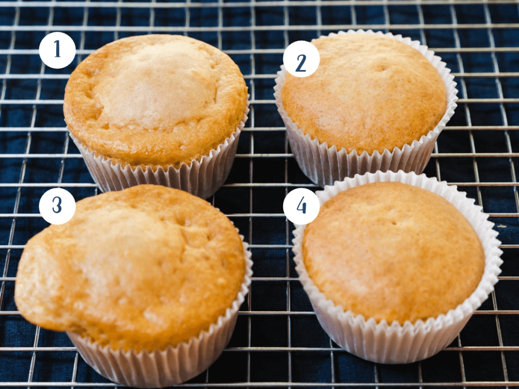Cooling rack with 4 muffins showing what a proper baked muffin looks like.