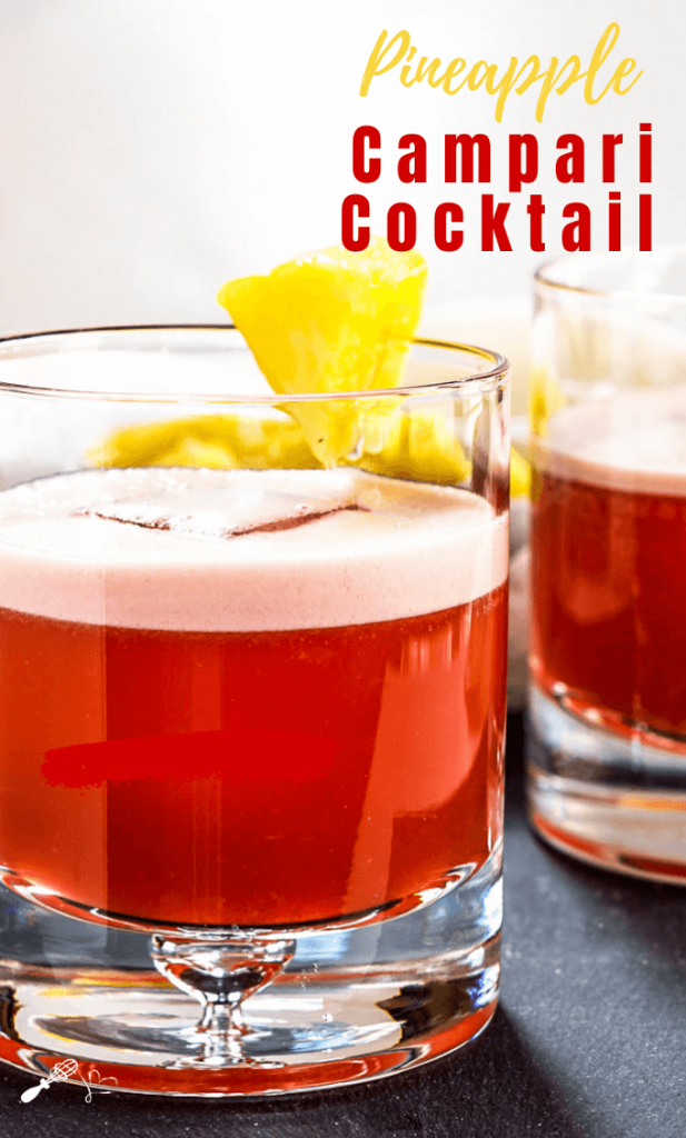 Sideview of two rocks glasses filled with a Campari Drink and garnished with pineapple.