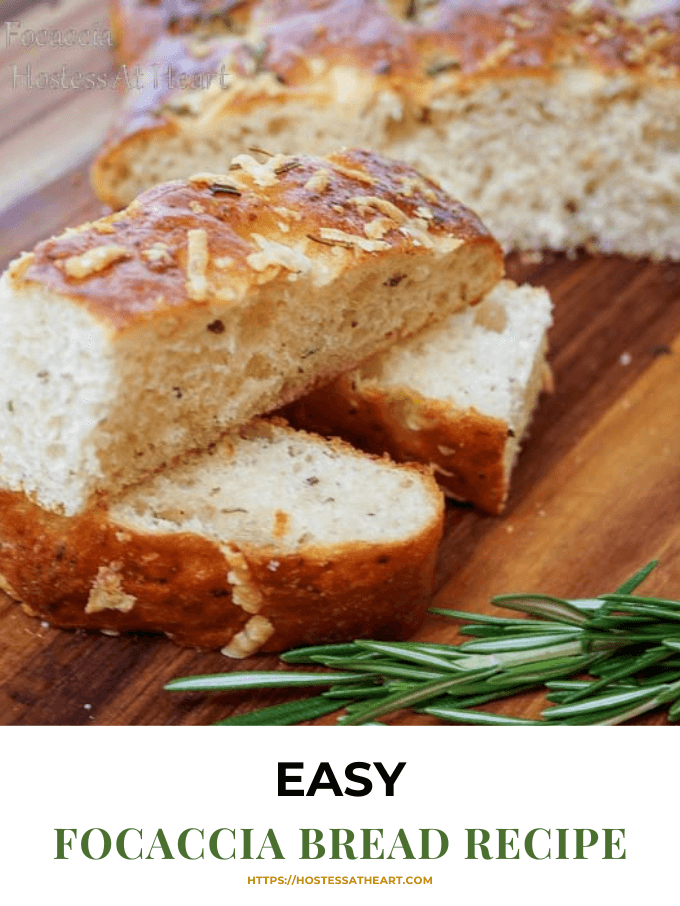 Three slices of Rosemary Focaccia Bread topped with cheese and herbs sitting in front of the loaf. Fresh rosemary sits in the front on a wooden cutting board.