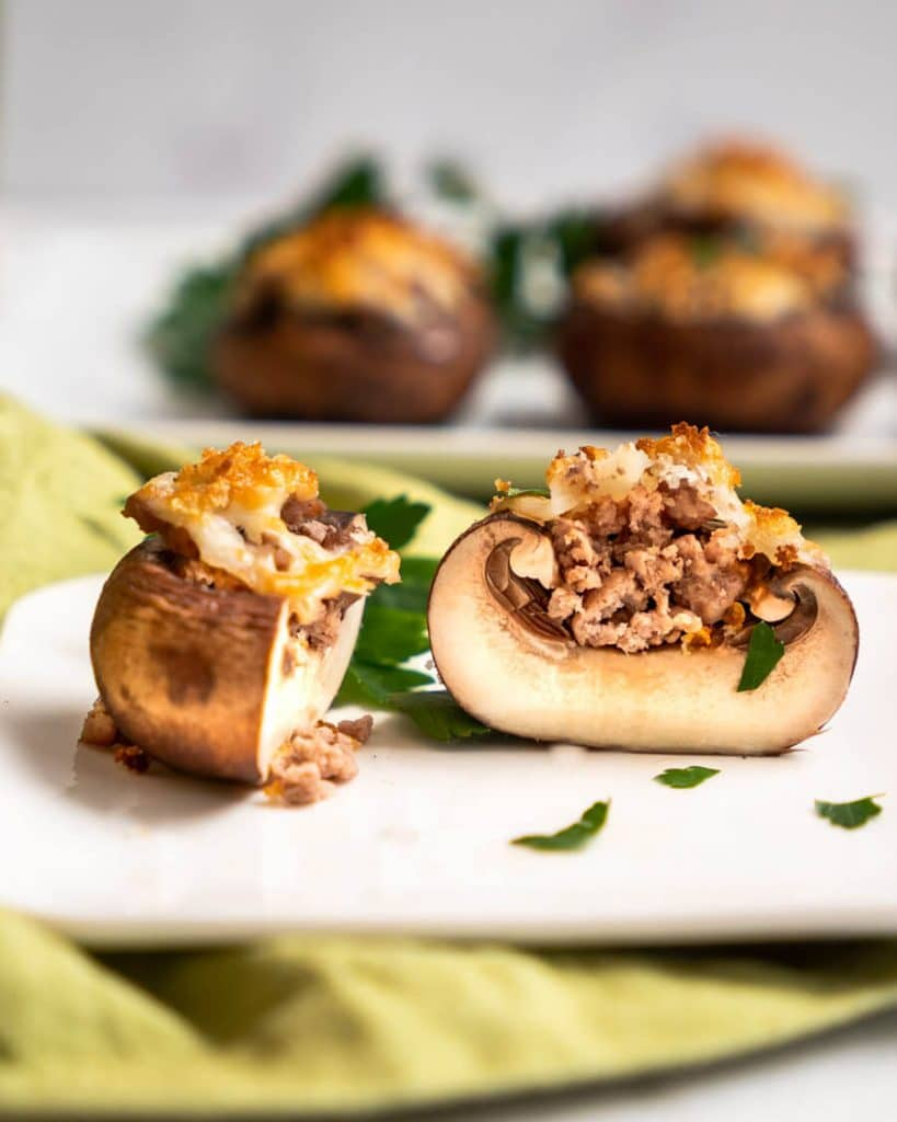 Tableview photo of a stuffed mushroom cut in half showing the filling.