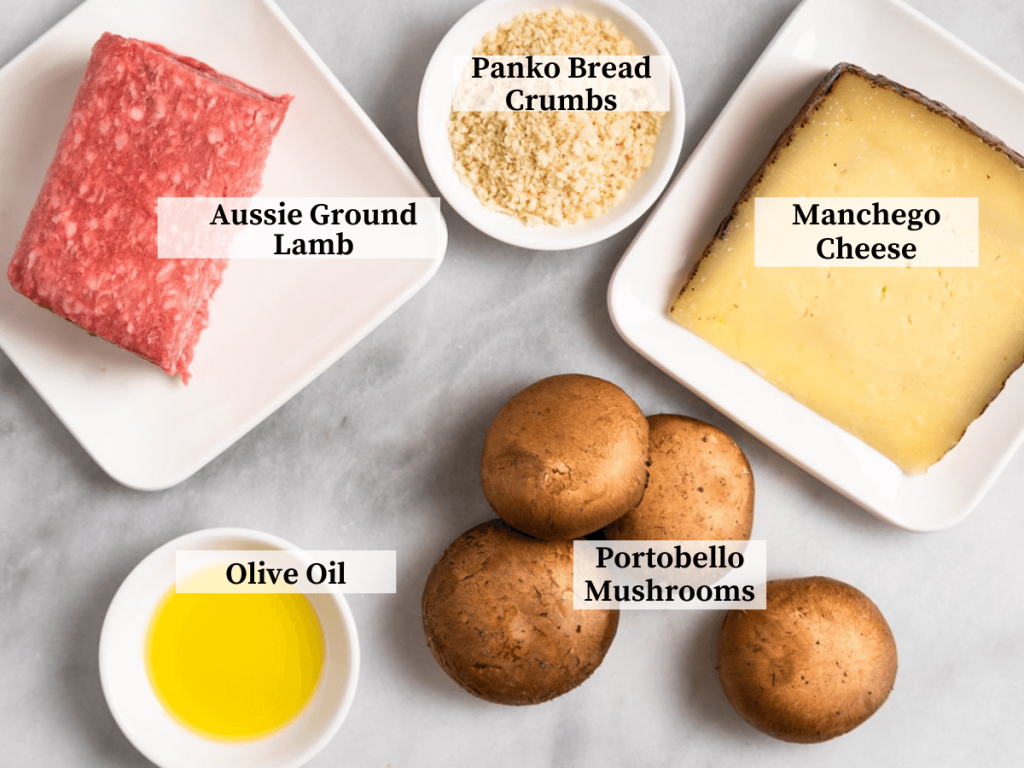 Ingredients used to make stuffed mushrooms including ground lamb, mushrooms, manchego cheese, and olive oil.