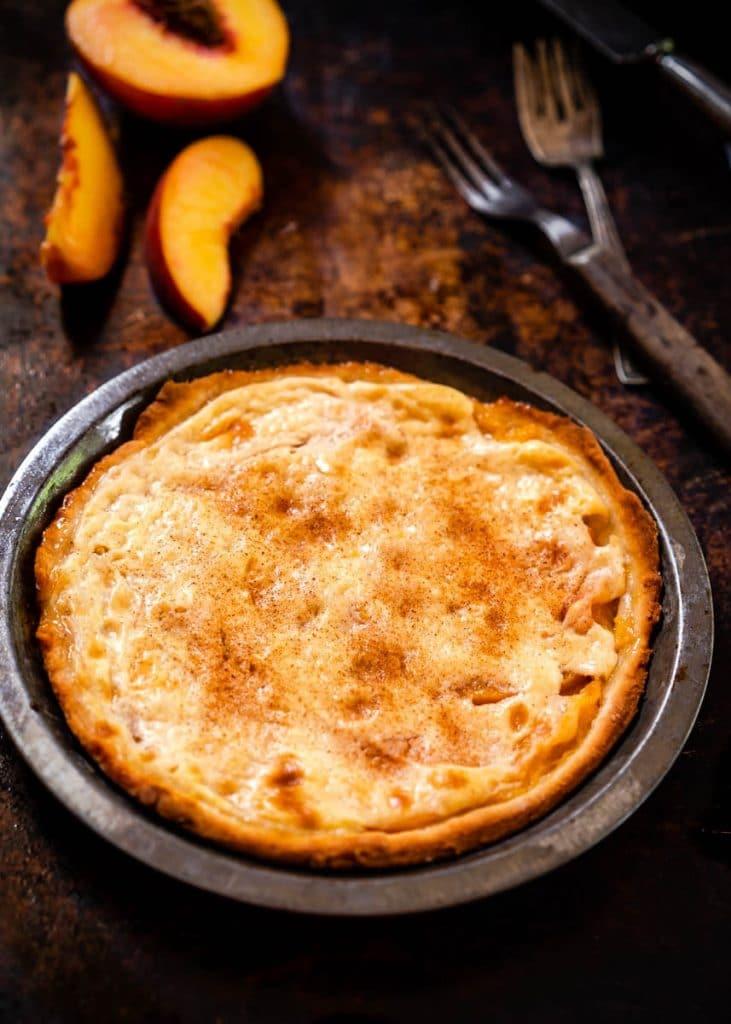 Top down photo of a Fresh Peach Dessert in a pie tin.