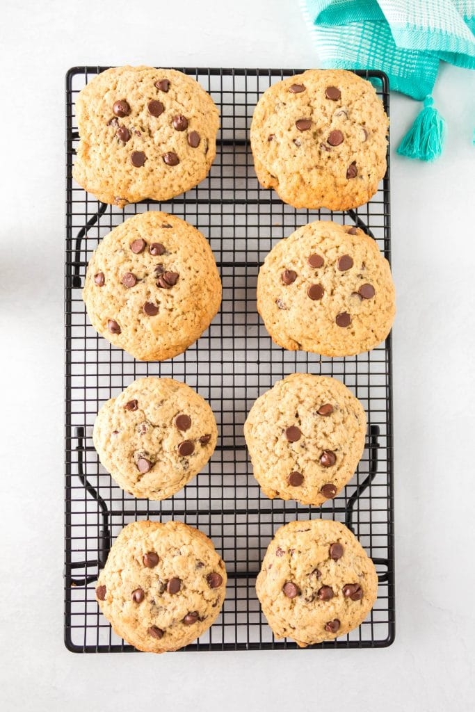 Top down view of chocolate chip cookies sitting on a cooling rack.