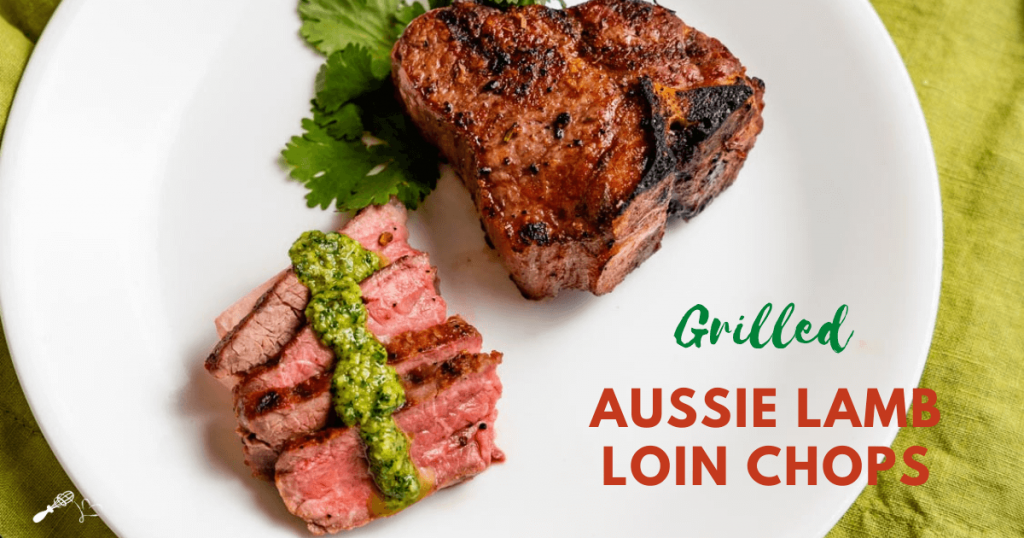 Sliced lamb with a drizzle of pesto in front of an uncut grilled lamb chop
