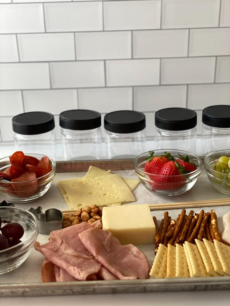 Make your own jarcuterie tray with fruit, meat, cheese, and nuts.