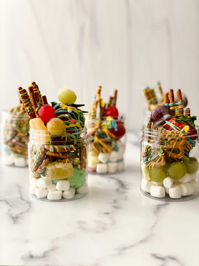 jars filled with sweet ingredients for jarcuterie.