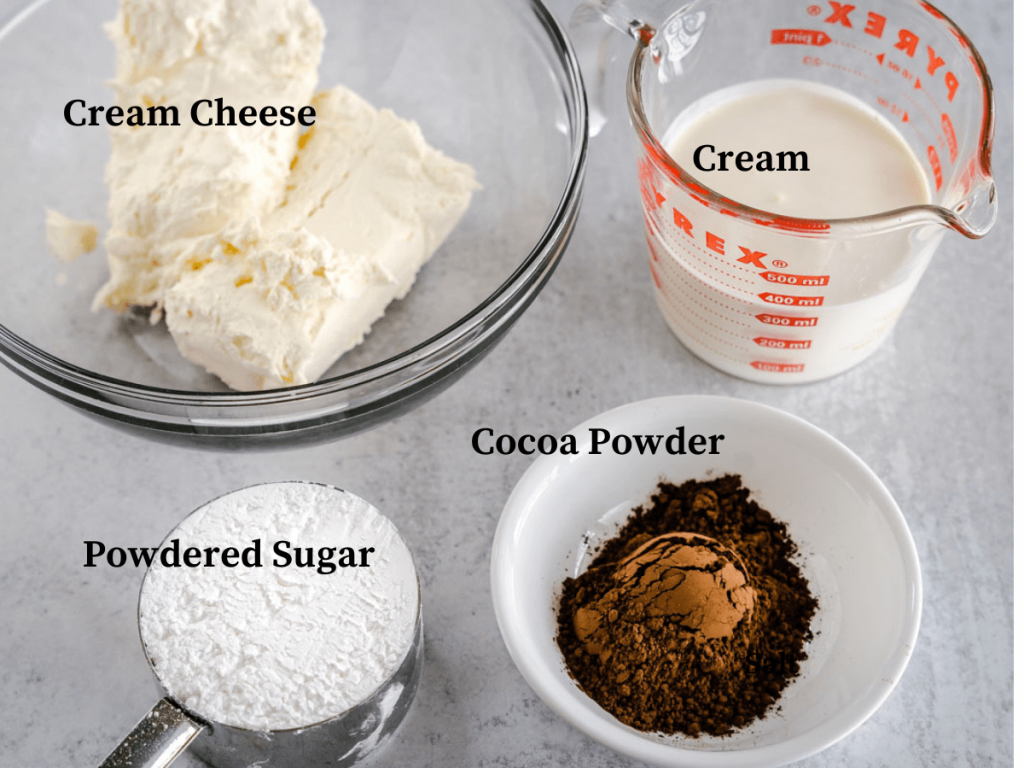 Ingredients used in chocolate cheesecake pie including powdered sugar, Cocoa Powder, Cream and cream cheese