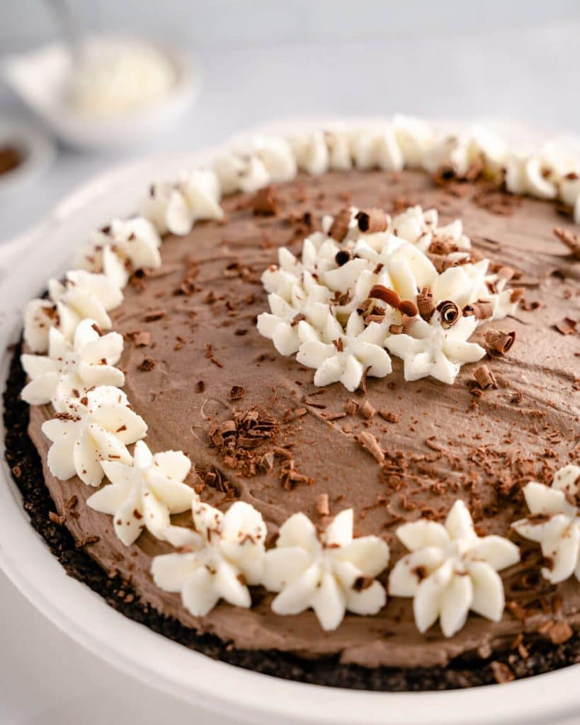 Close-up 3/4 Angle of a chocolate pie decorated with whipped cream stars and chocolate curls