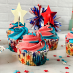 Red, White, and Blue cupcakes with swirled frosting in star cupcake liners