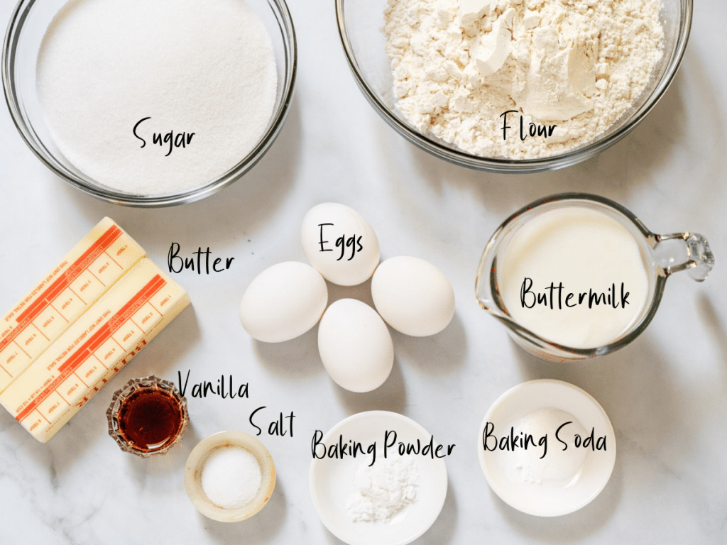 Ingredients used to make a Kentucky Butter Cake including butter, vanilla, salt, baking powder, baking soda, buttermilk, eggs, sugar and flour