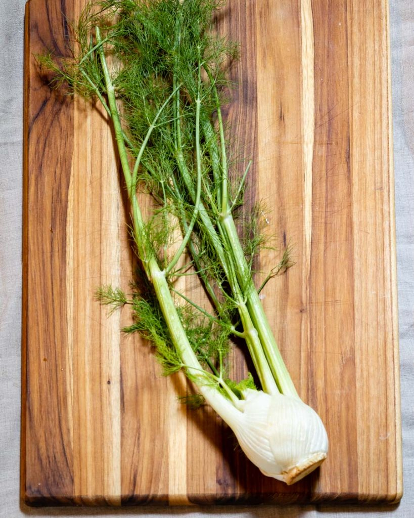 fennel on a cutting board, ready to be chopped.