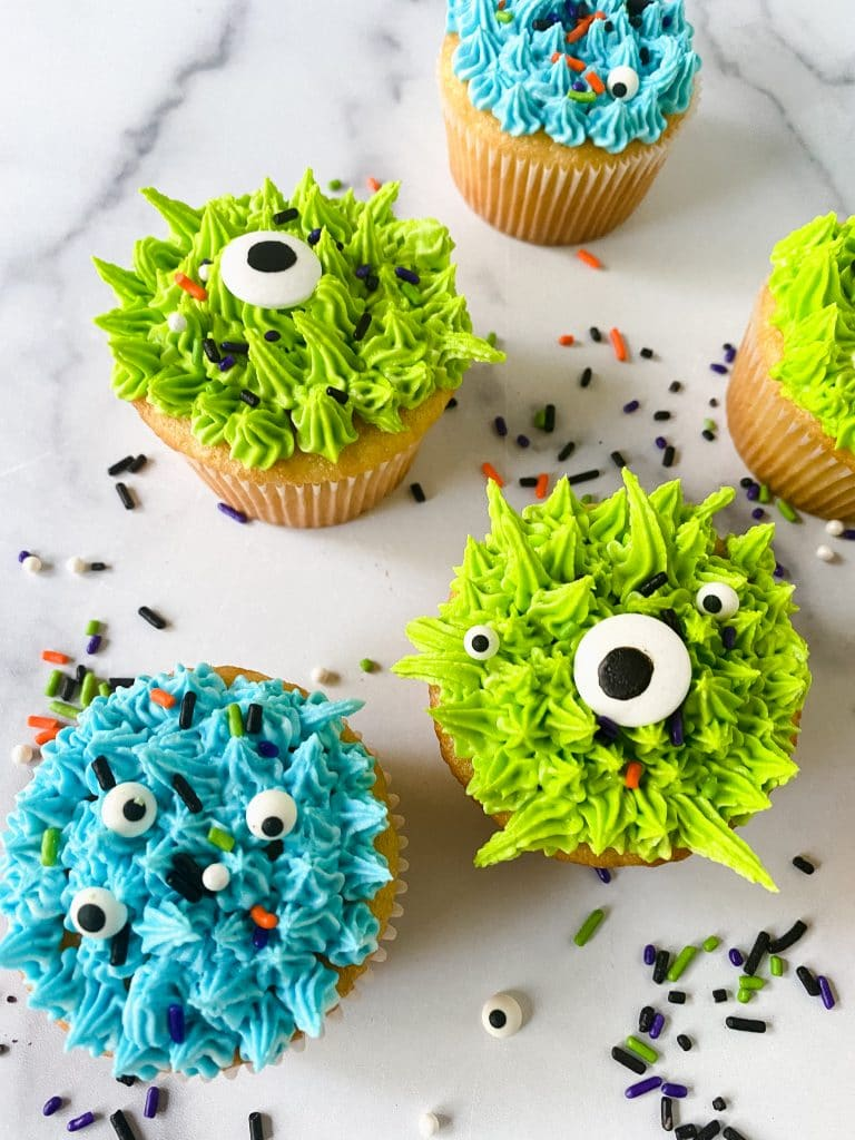 Super cute monster cupcakes with eyes.