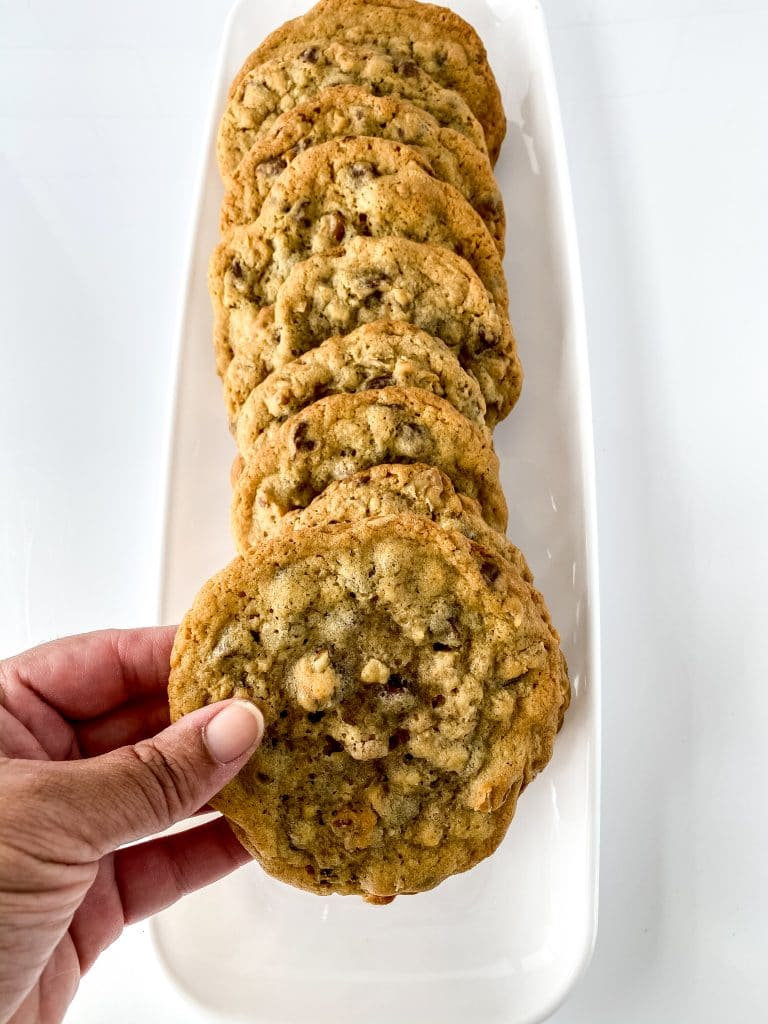 Stacked chocolate chips on a white plate.