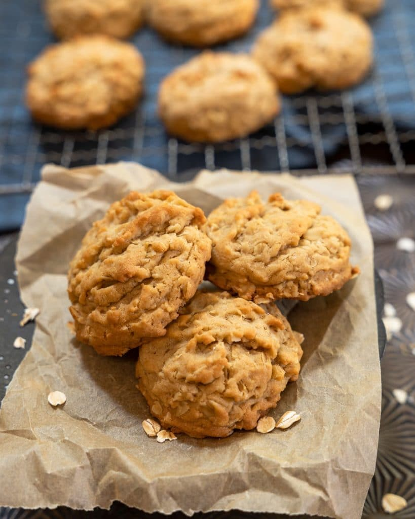 Easy oatmeal cookies on a cooling rack with three in focus.