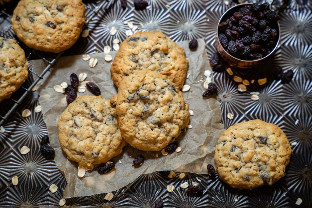 Several of the best oatmeal raisin cookies on a countertop.